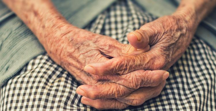 old women with hands in her lap