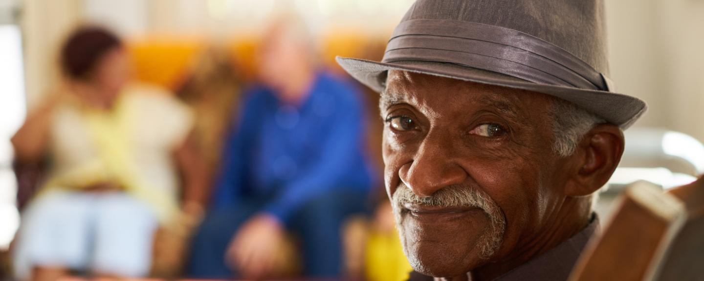 Man smiling at the camera in a care home