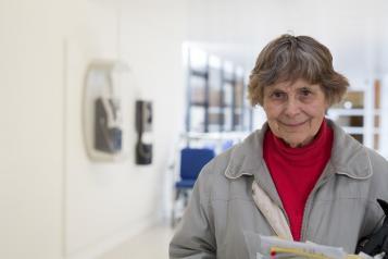 Woman stood in hospital corridor