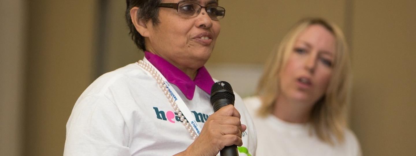 Two women promoting healthwatch services